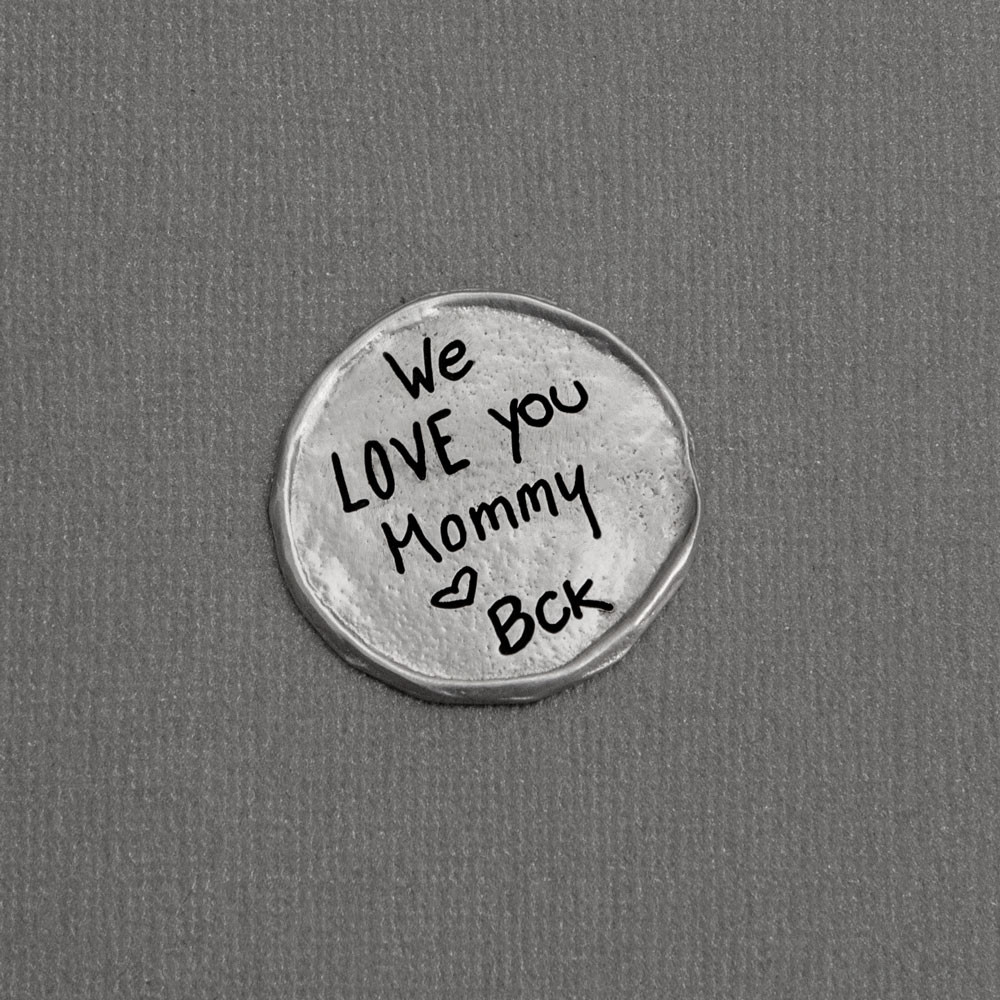 My Mantra Handwriting Pocket Token in fine pewter, shown from the top