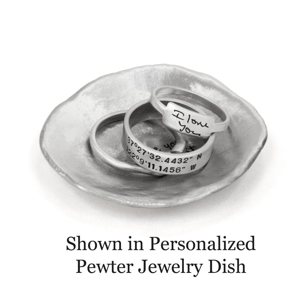 Sterling silver ring with hand stamped coordinates, shown in a personalized pewter jewelry dish