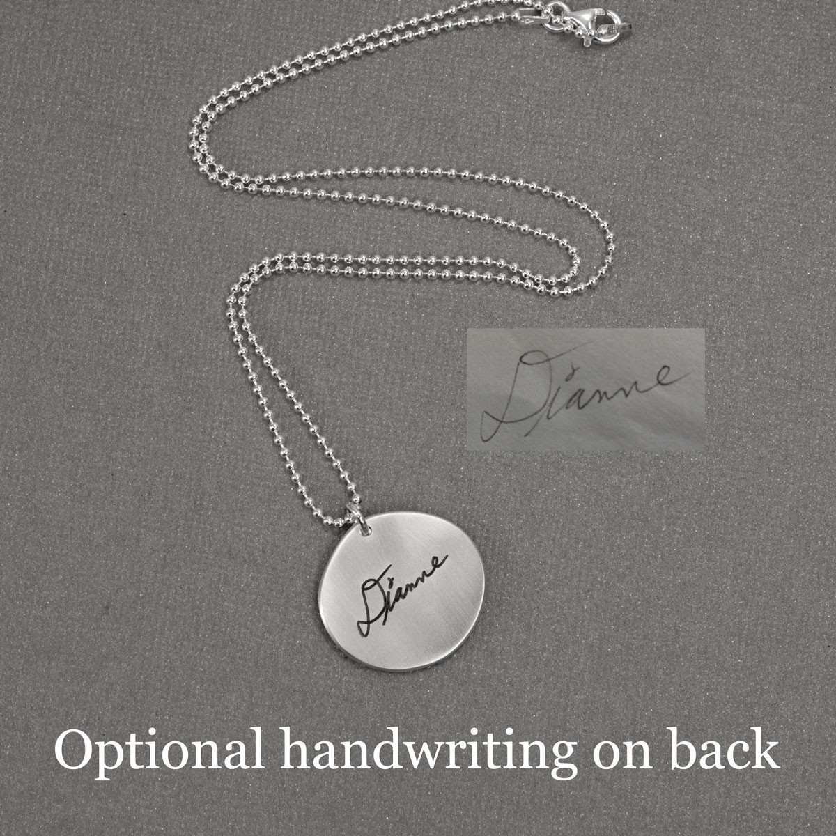 Silver memorial handwriting jewelry necklace in silver, shown with original writing