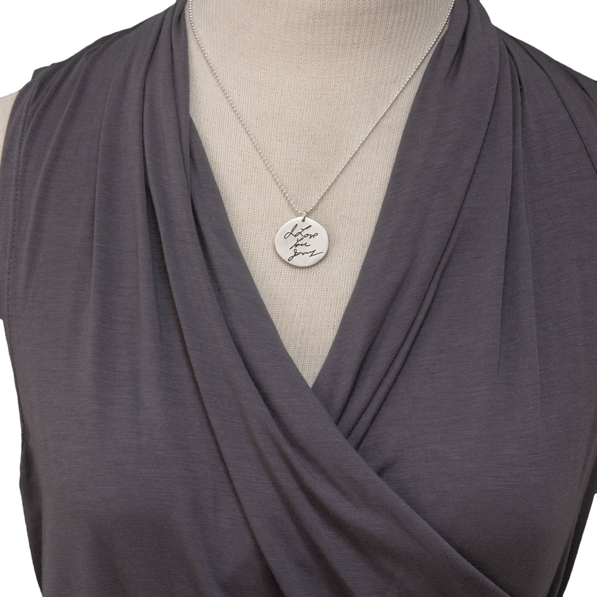 Memorial handwriting jewelry necklace in silver, shown on a model