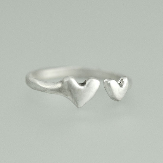 Hand crafted silver ring with two hearts, side view