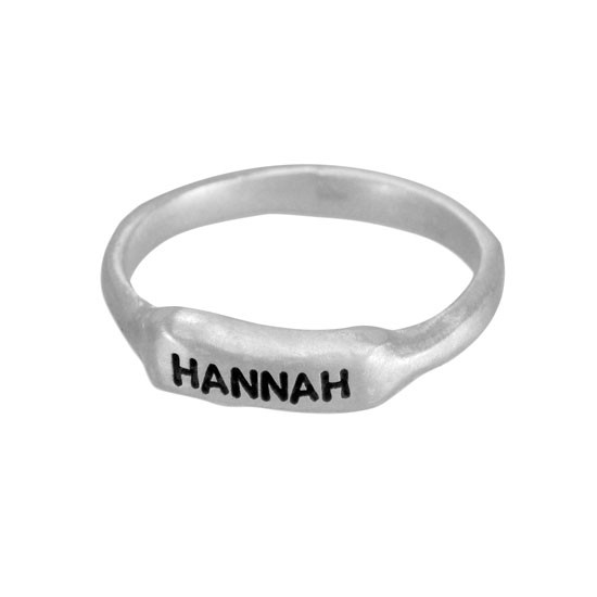 Sculpted silver bar ring, hand stamped with a name shown on white background shown from the side