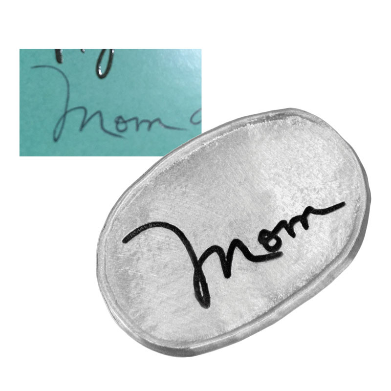 Handwritten note on fine pewter personalized oval pocket charm, shown with the original handwriting used to create it