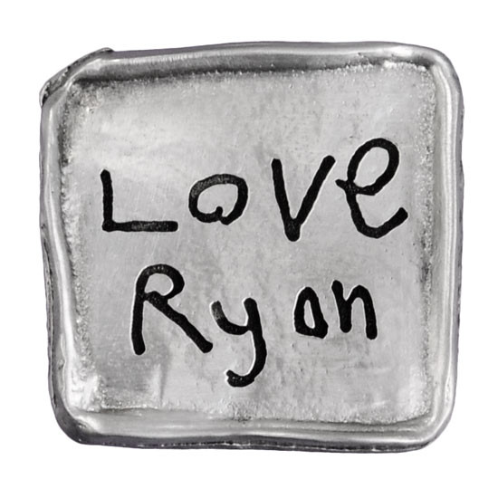 Handwriting on pocket charm