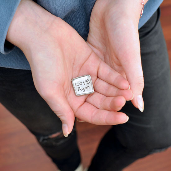 Personalized pocket token held in hands