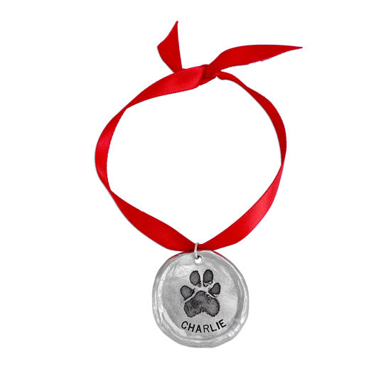 Custom fine pewter Christmas ornament, personalized with your dog or cat's pawprint, shown on white
