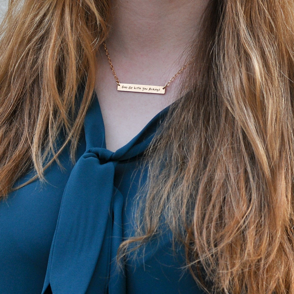 Gold bar necklace with your actual handwriting, shown on a model