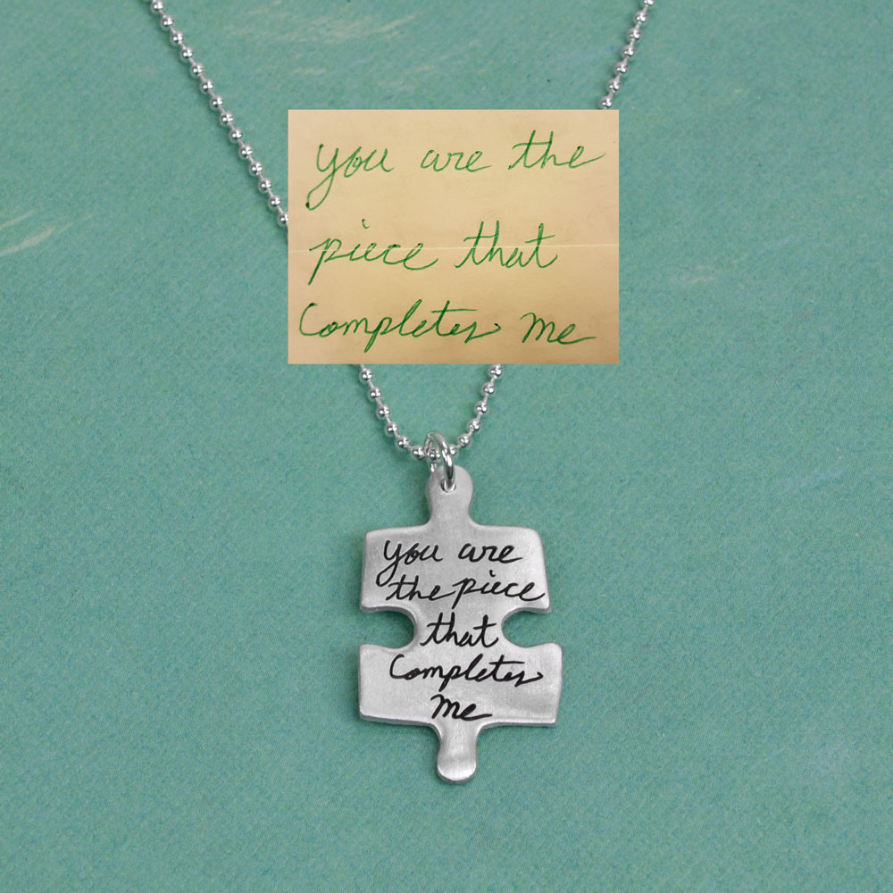 Child's handwriting puzzle necklace in silver, shown with original handwritten note