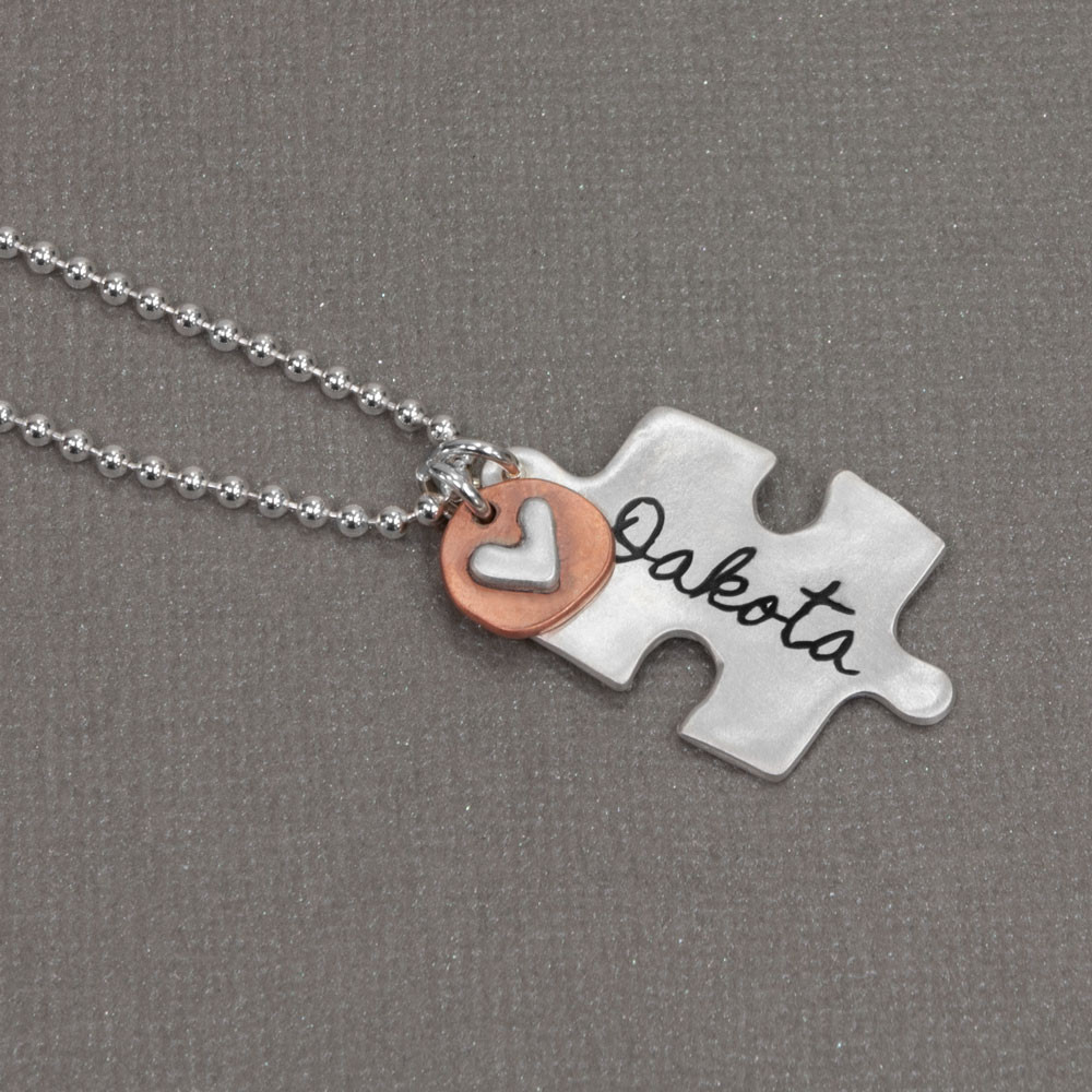 Custom handwriting puzzle charm in silver, with name, shown from side