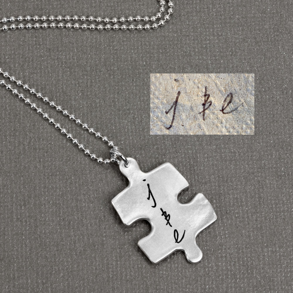 Silver Puzzle necklace with handwritten saying, shown close up, with original handwriting used to create it