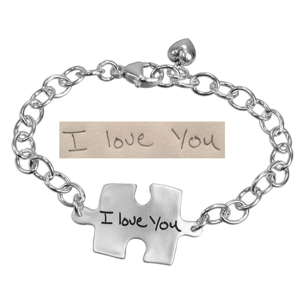 Puzzle charm custom silver handwriting bracelet, shown with original handwritten note