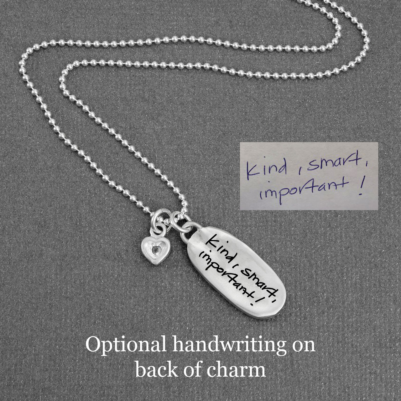 Handwriting on silver oval necklace, with the actual handwriting, showing the back of charm