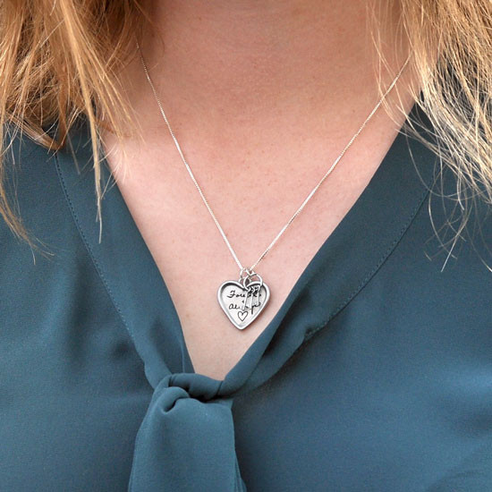 Large silver heart handwriting necklace with keys to your heart, shown on a model
