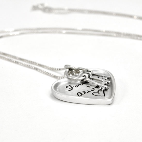 Large silver heart handwriting necklace with keys to your heart, shown close up on white from the side, with Forever and Always engraved on it