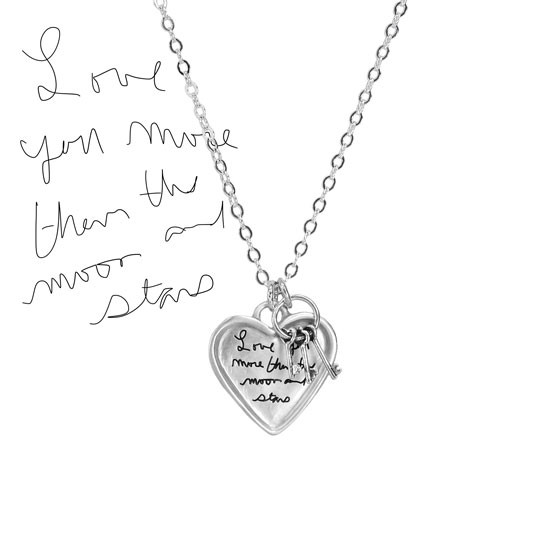 Mom's note in her handwriting on a custom silver heart pendant, shown on white with the original handwritten note