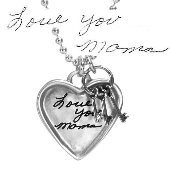 Large silver heart handwriting necklace with keys to your heart, with original writing saying Love You Mama, shown close up on white