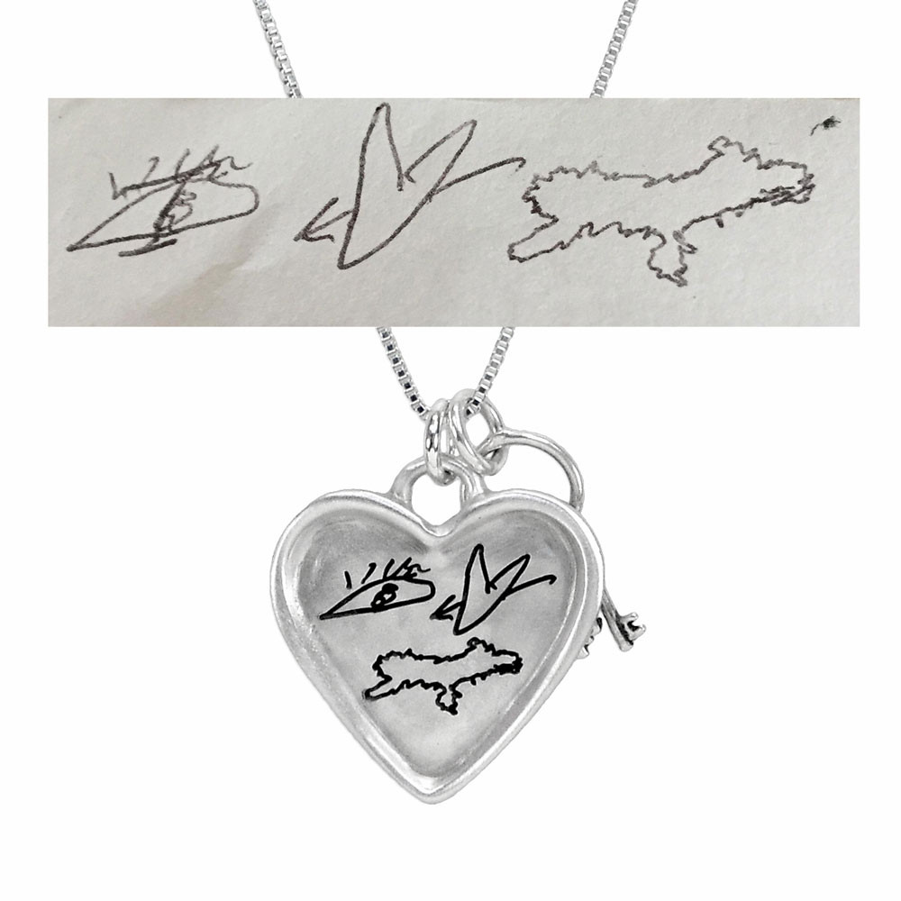 Large silver heart handwriting necklace with keys to your heart, with original artwork saying Eye Love You, shown close up on white