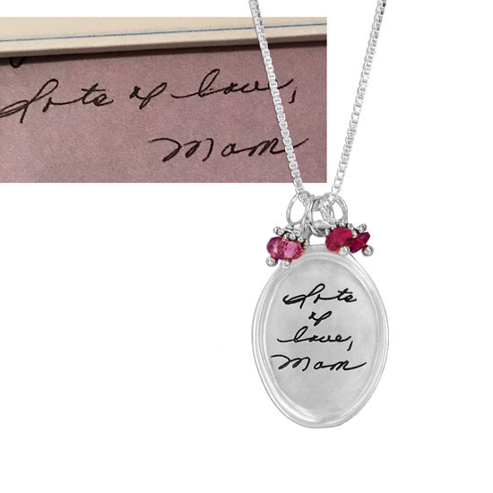 Silver raised edge oval handwriting necklace shown with the actual handwriting used to make it