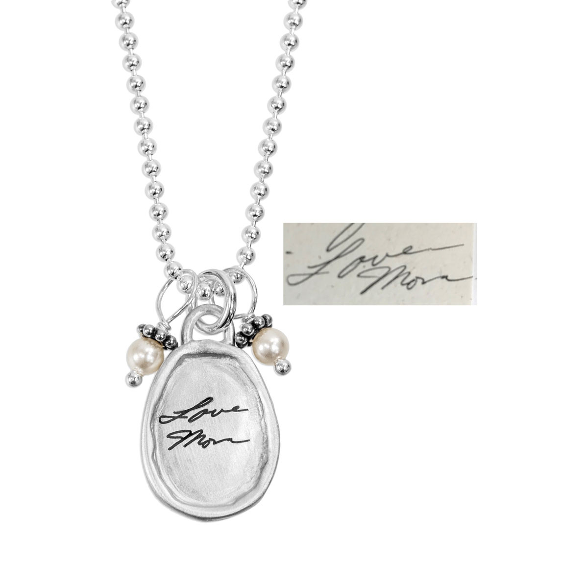 Small silver oval handwritten necklace, shown with original handwriting