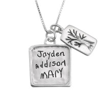 Handwritten names on a charm
