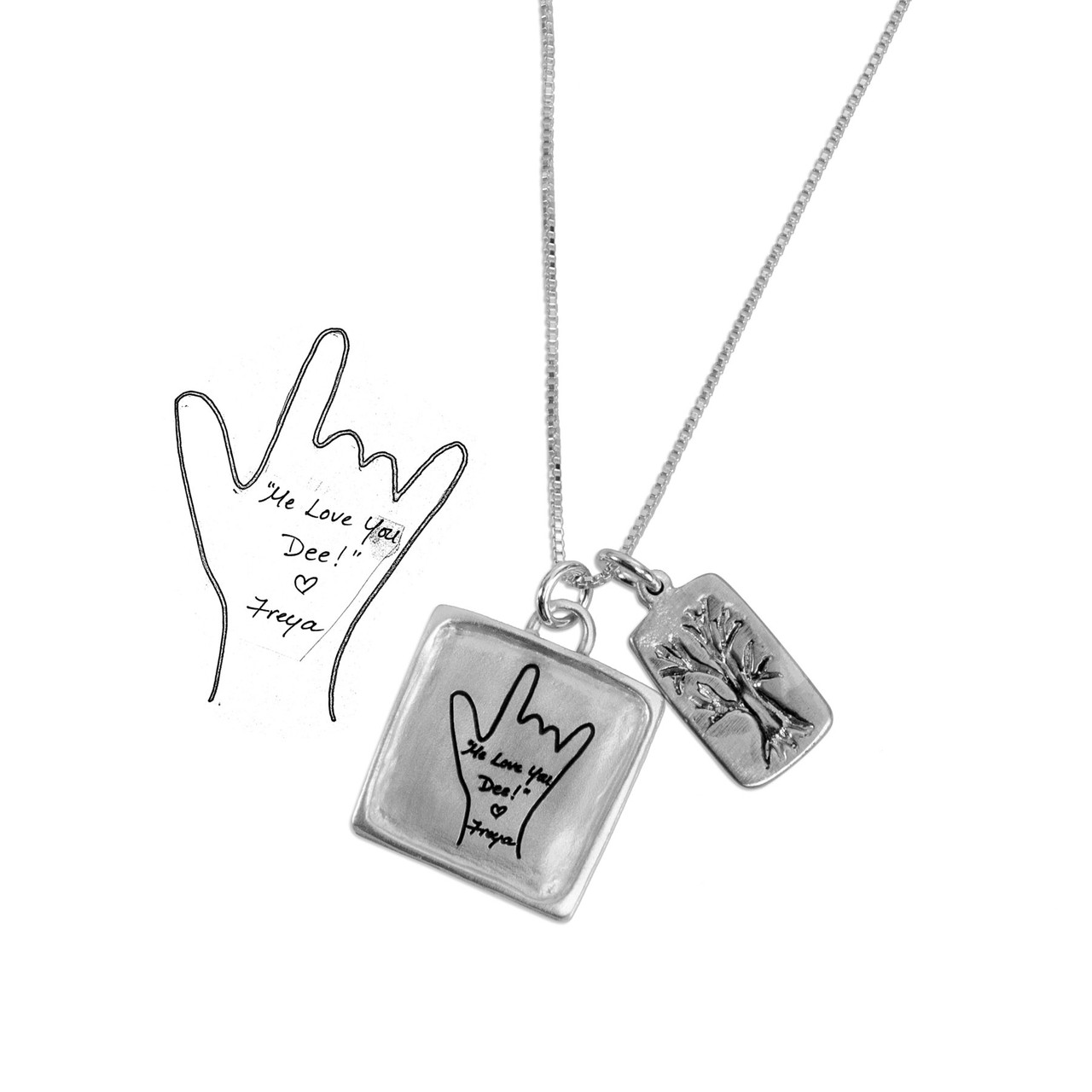 Silver Family Sculpted Raised Edge necklace with handwriting, shown on a model