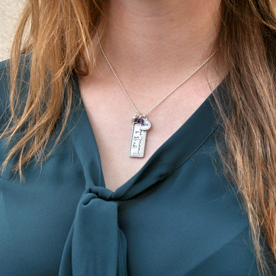 Established family necklace heirloom from silver rectangle, shown on a model