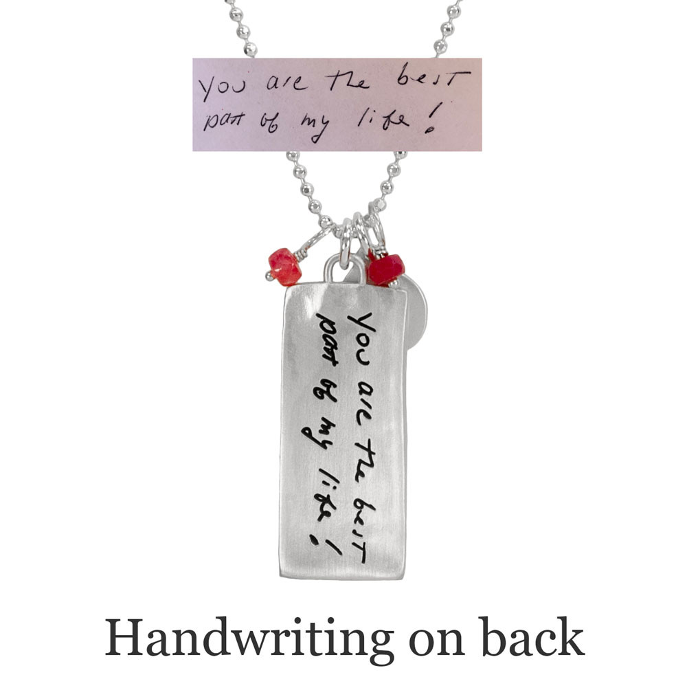 Back side of rectangle family necklace in silver with handwriting, shown with original handwriting etched on the back