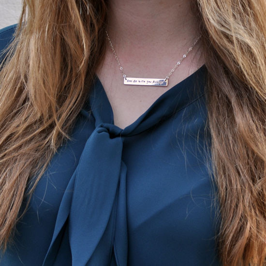 Silver Handwriting bar memorial necklace with actual handwritten signature, with embedded birthstone, shown on model