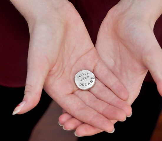 Fine Pewter Nugget personalized pocket token with inspiring message, shown in hands