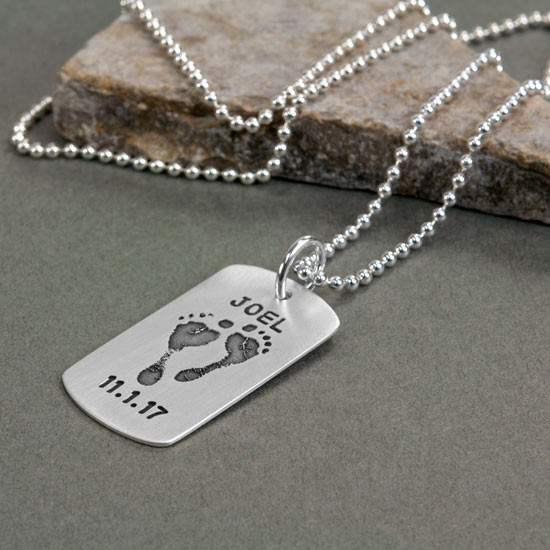 sterling silver military dog tag personalized with your baby's custom footprints or handprints, shown from the side
