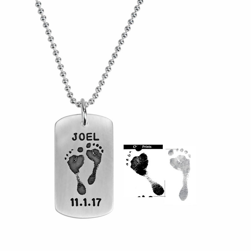 sterling silver military dog tag personalized with your baby's custom footprints or handprints, shown with footprints used to create it