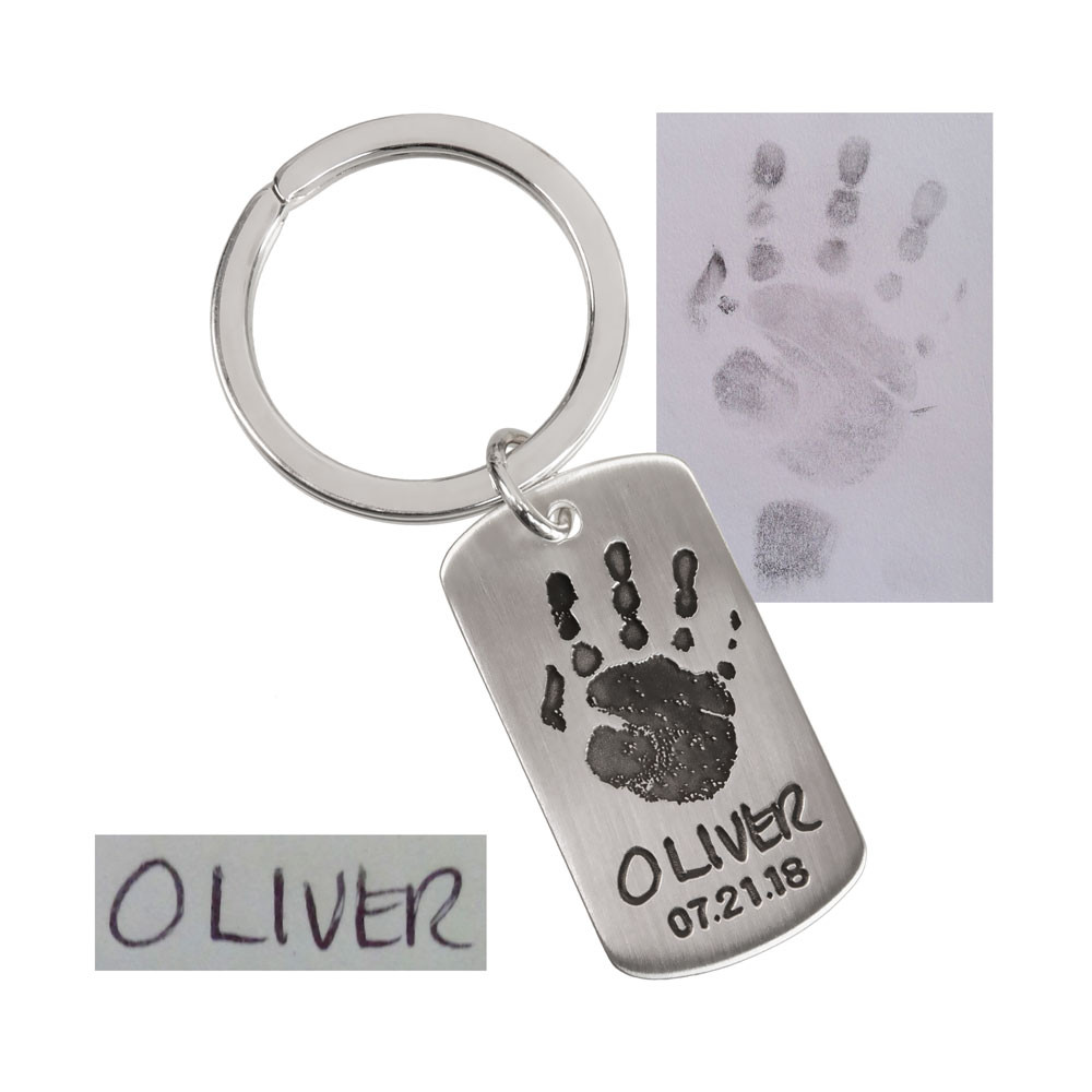 sterling silver military dog tag personalized with your child's custom handprints, shown with handprints & handwriting used to create it