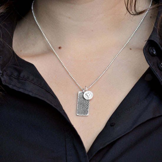 Custom Silver fingerprint necklace, personalized with your loved one's fingerprint, shown on a model