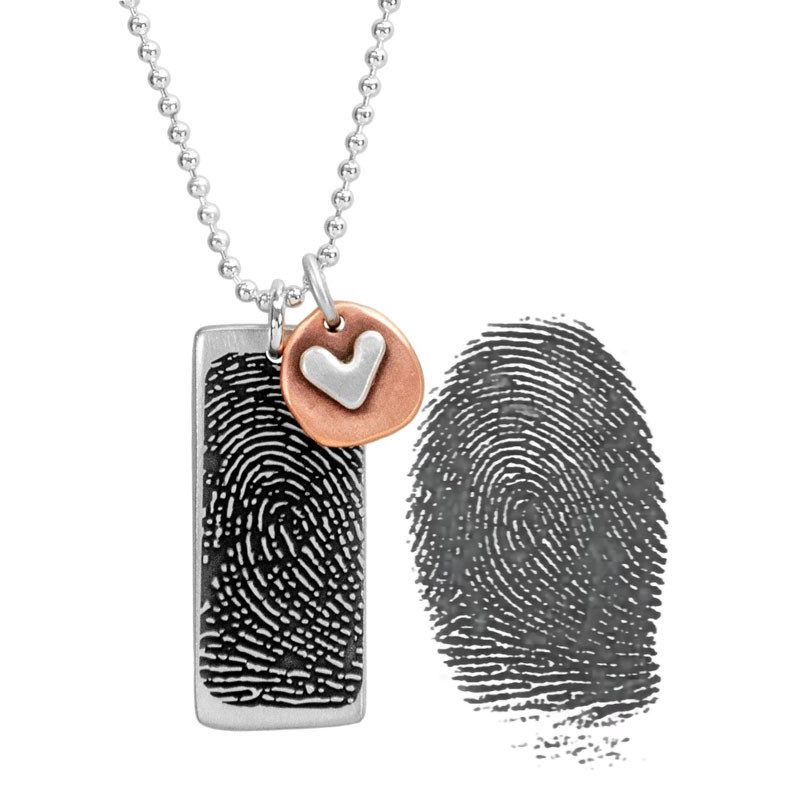 Custom Silver fingerprint necklace, personalized with your loved one's fingerprint, showing the actual fingerprint used to create it