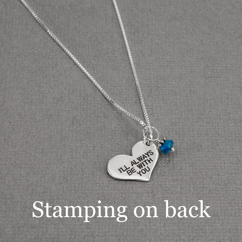 Silver fingerprint heart necklace with birthstone, shown with optional stamping on back