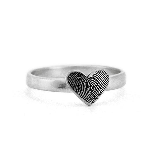custom heart shaped fingerprint jewelry ring in sterling silver, shown from side close up