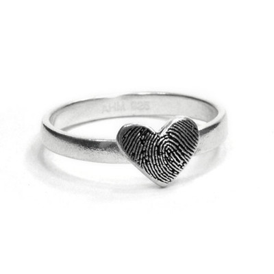 custom heart shaped fingerprint jewelry ring in sterling silver, shown on white