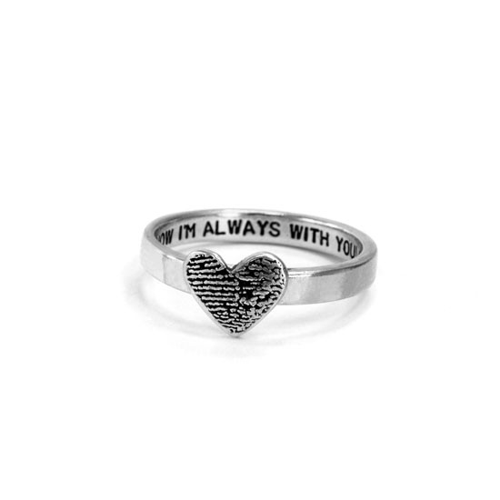 custom heart shaped fingerprint jewelry ring in sterling silver, shown with optional stamping on the inside