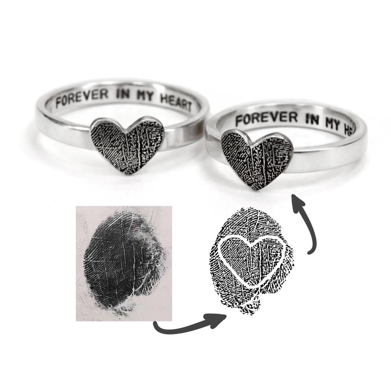 custom heart shaped fingerprint jewelry rings in sterling silver, shown on with original fingerprint
