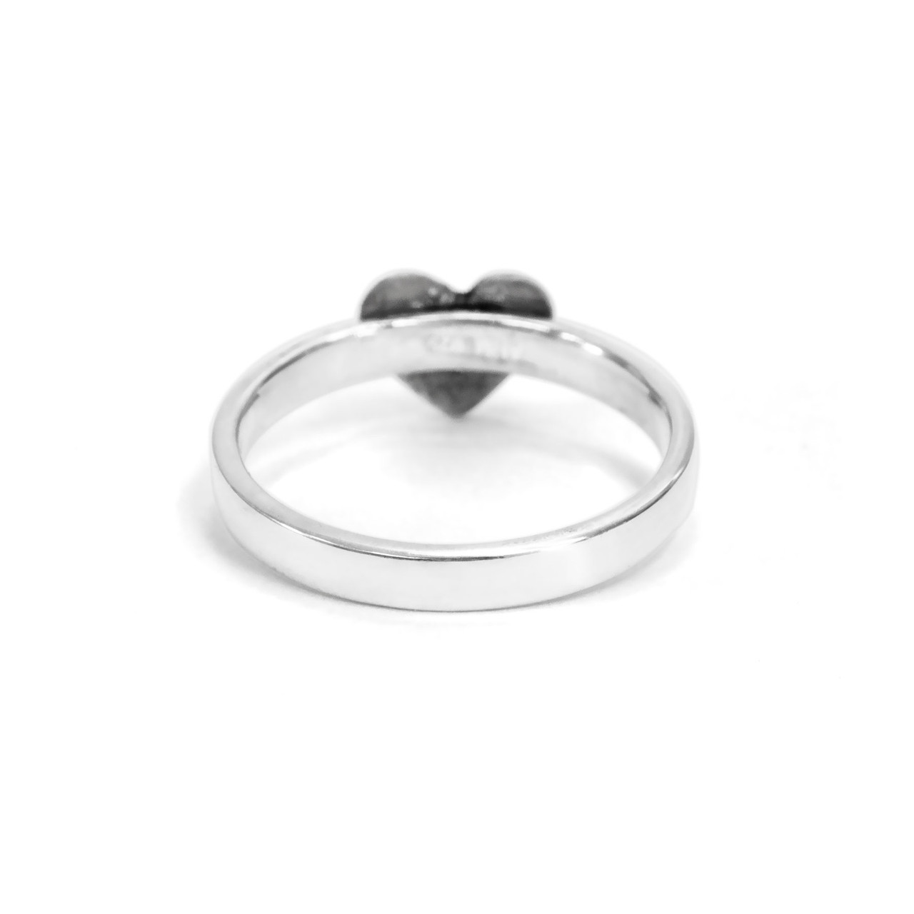 custom heart shaped fingerprint jewelry ring in sterling silver, shown from the back, on white