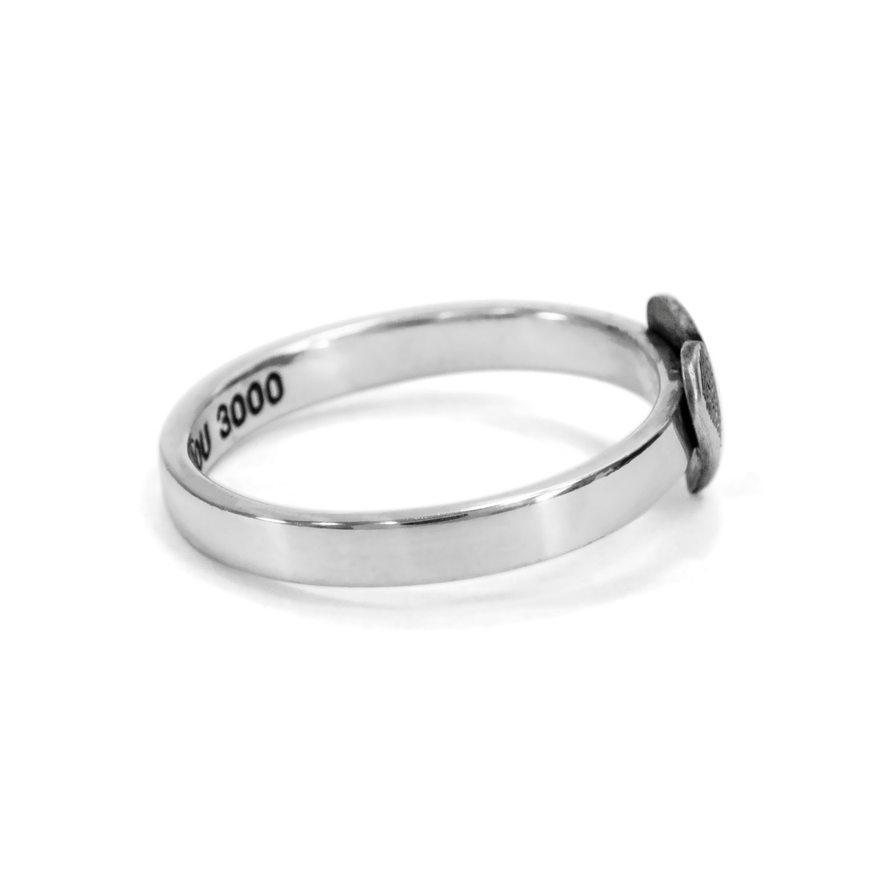 custom heart shaped fingerprint jewelry ring in sterling silver, shown from the side, on white