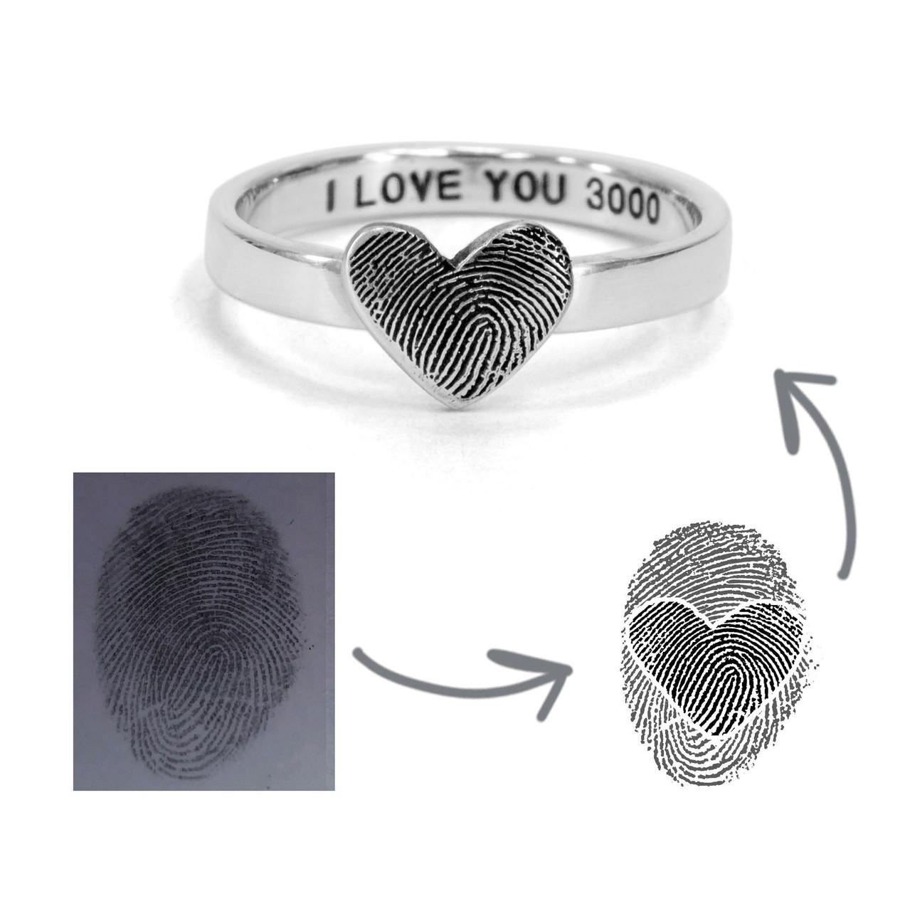 custom heart shaped fingerprint jewelry ring in sterling silver, shown on with original fingerprint