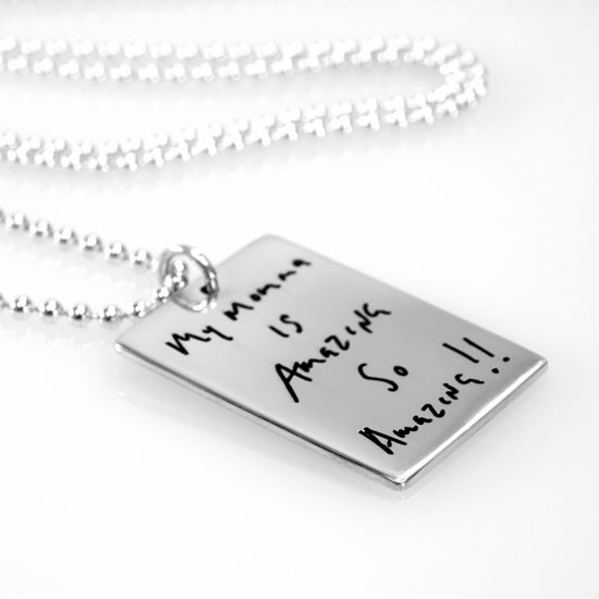 Necklace with handwritten note on custom silver rectangle tag for mom, shown from the side