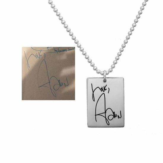 Necklace with handwritten note on custom silver rectangle tag, shown with original handwriting used to create it