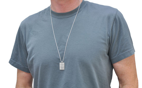 Necklace with handwritten note on custom silver rectangle tag for man or woman, shown on a model