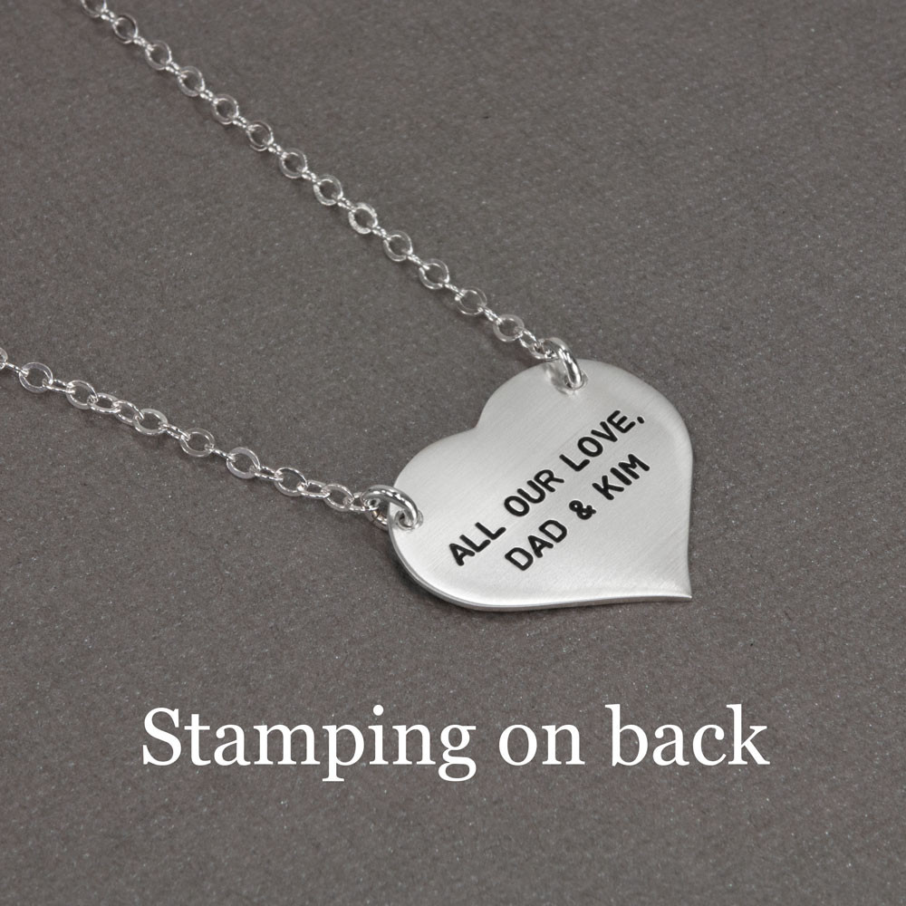 Children's footprints necklace, on a sterling silver heart, with the name hand stamped on the edge of the charm, shown with stamping on the back
