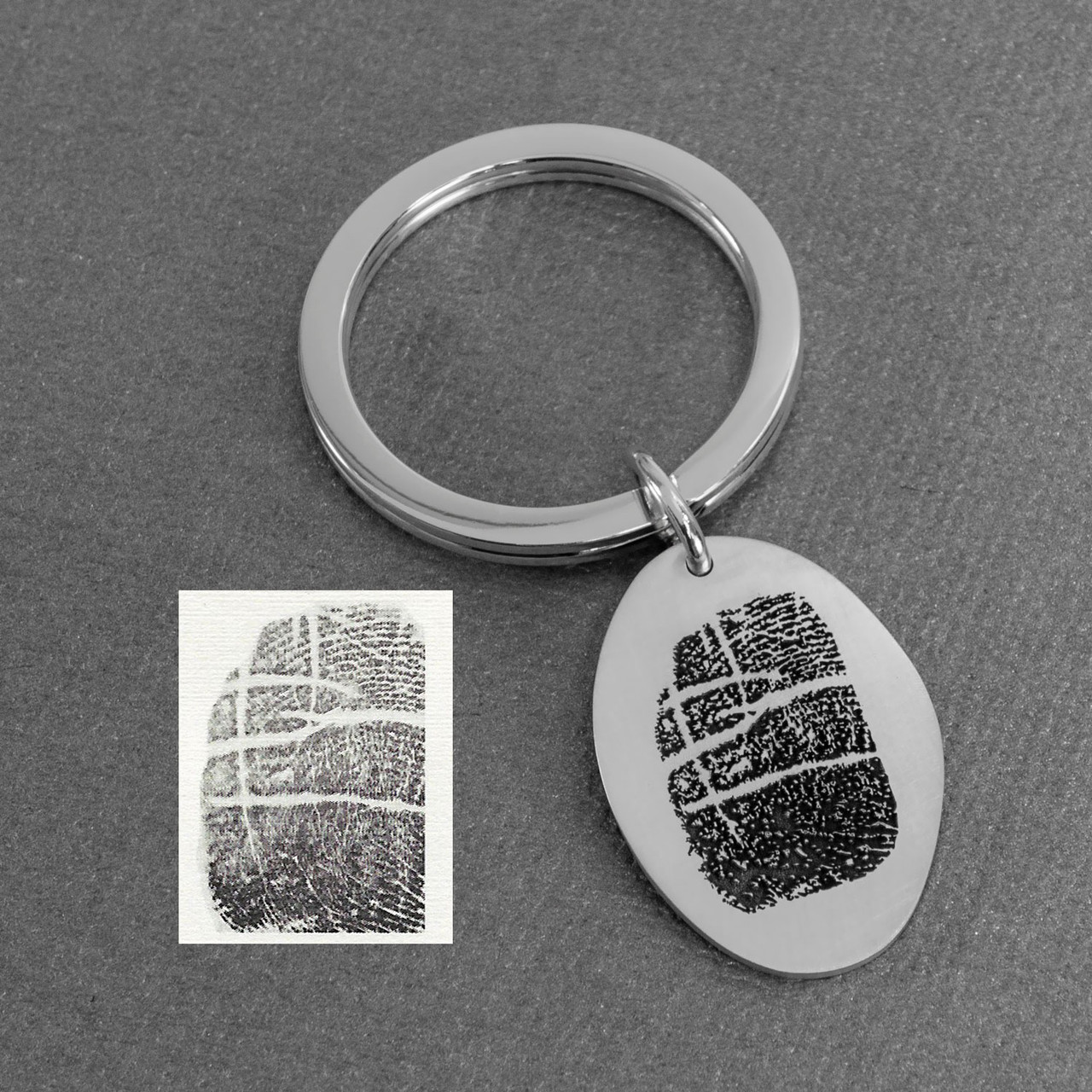 fingerprint key ring memorial in sterling silver on a white background