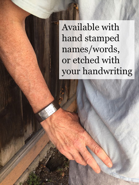 Hand stamped or handwriting leather bracelet, shown on a model