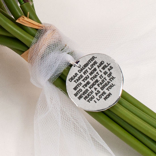 Custom hand stamped note on bouquet, close up