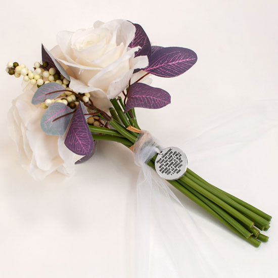 Back of hand stamped charm on bouquet showing personalized note